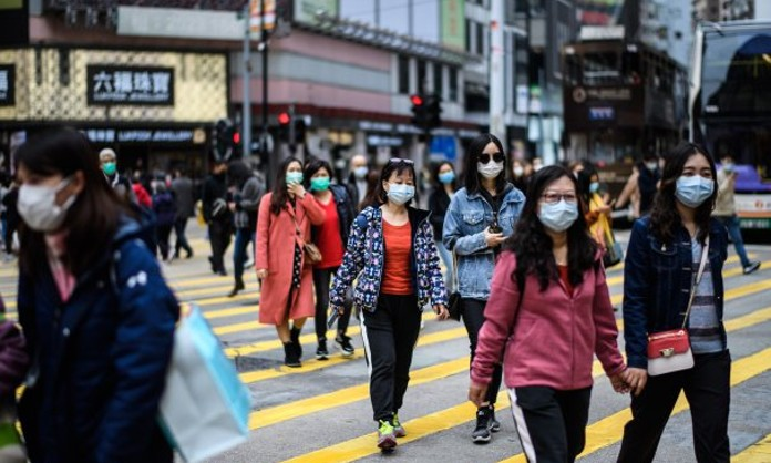 China reconoce que no hay cubrebocas suficientes